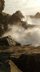 Waves battering coastal rocks